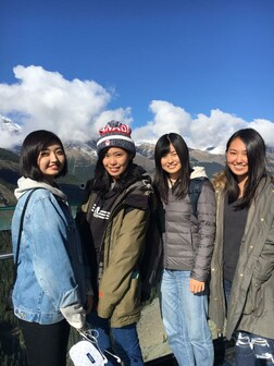 Group of four young students on a hiking trip