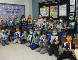 Class holding their Halloween art projects