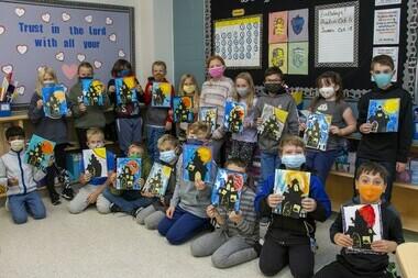 Class holding their Halloween art projects